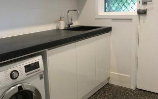 Polished concrete floor laundry area